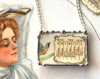 Recycled china necklace. Broken china jewelry necklace antique 1916 calendar plate November birthday bluebird