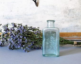 Vintage glass bottle, Whittemore Boston French Glass Bottle, collectable vintage bottle, blue glass, small vase.