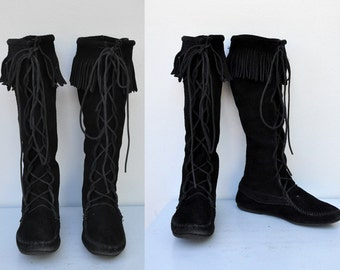 MINNETONKA Tall Boots Knee High Lace-up Black Suede Moccasins Leather with Fringes Boho Hippie Festival size 8 - 8.5