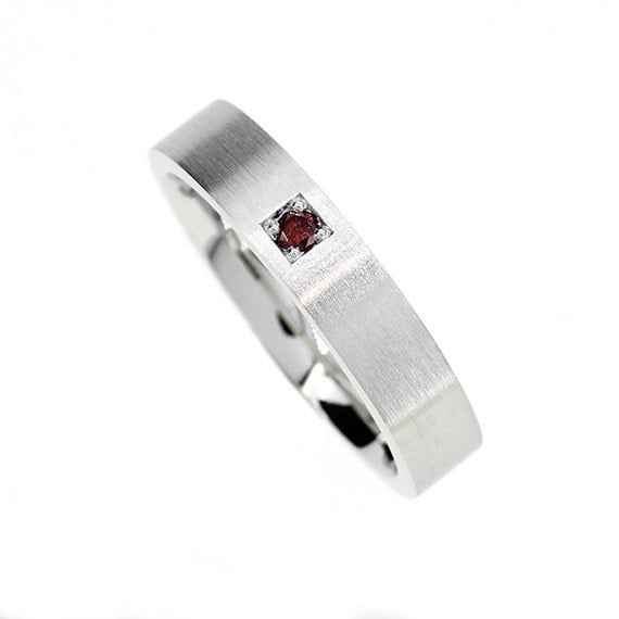 finnish origin garnet wedding band made from white gold man