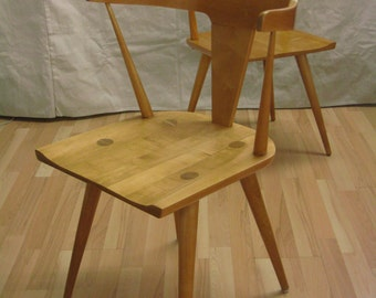 Pair Paul McCobb planner group chairs in solid maple