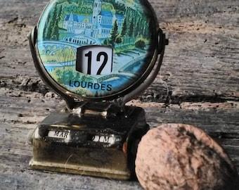 Souvenir French perpetual desk calendar from Lourdes