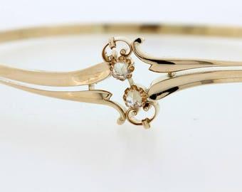 14K hinged bracelet with Rose cur Diamonds