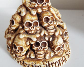 Vintage  Sandstone  Mountain of Skulls with the saying... 'Only the strong survive'