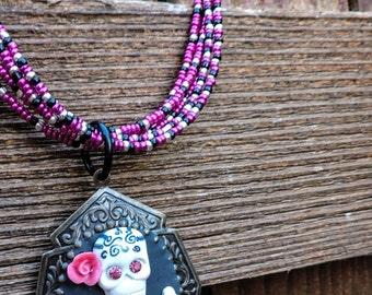 Skull and cross bones flower cameo necklace