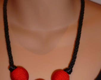 Black braid necklace with red beads