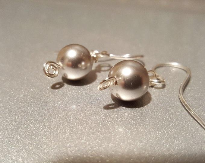 Light gray Pearl earrings on Sterling Silver French ear wires. Luminous Grey pearl earrings on 999 fine silver