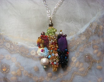 india - a mixed media necklace delicately embroidered with a silver chain