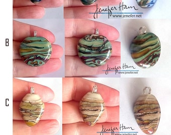 EXPERIMENTS! twelve lampworked glass pendants made by Jenefer Ham