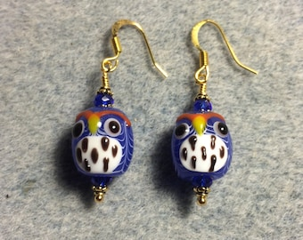 Blue and white spotted lampwork owl bead earrings adorned with blue Chinese crystal beads.