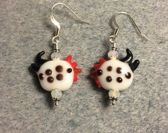 Small white with black spots rooster bead earrings adorned with white Chinese crystal beads.