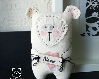 White textile Babu Cona. Fun as a baby shower gift for a girl and baby room deco.