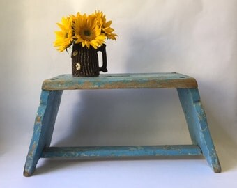 modern farmhouse wooden stool in layers of old blue chippy paint, handmade, dovetailed, antique primitive small bench, vintage rustic decor