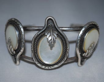 Sterling silver cuff bracelet with Mother of Pearl setting.