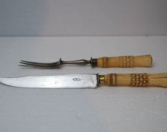Antique French  carving set with large knife and fork. Bone handles.  Beautiful design. Thinet Paris. Good overall  condition.