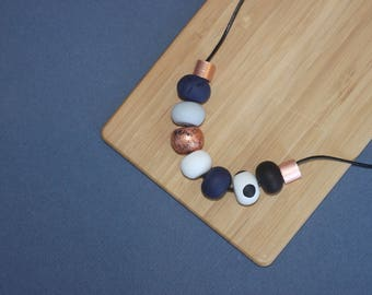 """Polymer clay necklace. Polymer clay bead necklace. Grey, black, navy white and copper beads! """"The sally'"""