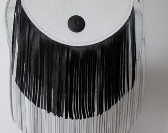 Cross body black and white leather bag with fringe