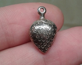 A solid sterling silver strawberry heart bracelet puff charm