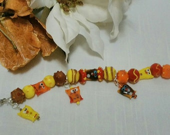 SALE!!!  Fun Owl Lampwork Beaded Bracelet, Orange Reds, Browns Yellows, Owl Beads and Charms, Stretchy Bracelet with Toggle Clasp