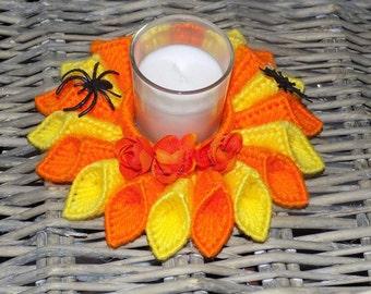 orange, yellow candle holder/