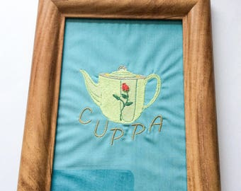 Framed embroidered teapot with flower