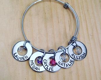 Mother's bangle bracelet: Swarovski birthstones and hand stamped washer name charm on an adjustable bangle bracelet. Stainles steel