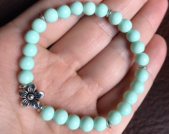 Pale Turquoise/Teal Bracelet with Silver Flower