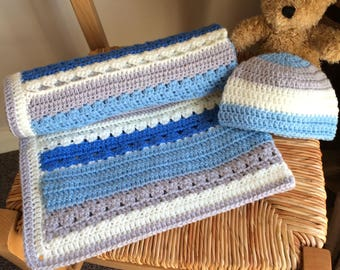 Handmade crochet baby blanket and hat set. Made using shades of blue, white and grey. Blanket approx 26 x 25 inches, the hat is newborn.