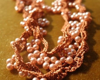 Soft orange crocheted necklace with pearlbeads - vintage