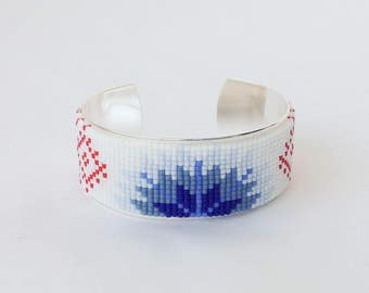 Cuff Bracelet silver with weaving of pearls with a motif of Estonian folklore