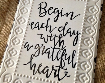 Begin Each Day Tin Sign