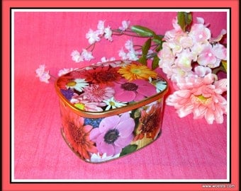 Vintage Cote D 'Or chocolates storage tin with colourful flower design.