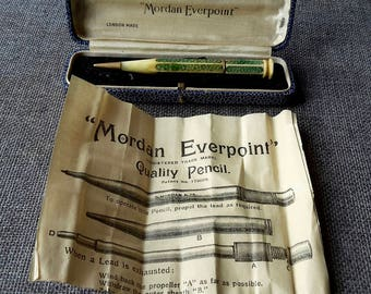 This is a very rare S Mordan & co vintage gold shark skin and bone propelling pencil in its original box and papers