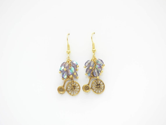 Golden bicycle earrings