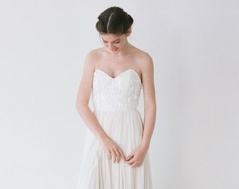 Madeline // An Ivory Sequinned Dress With Shimmer Godets Within a Chiffon Skirt