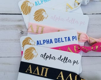 ALPHA DELTA PI | First. Finest. Forever. Series | One Hair Tie with Card | You Choose Colors | Officially Licensed