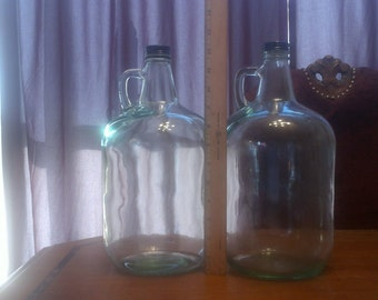 matching gallon wine bottles greenish glass 8.00 each.