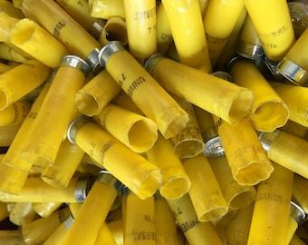 30 yellow 20 gauge shotgun shell hulls
