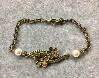 Antique Bronze flower and swarovski pearl bracelet