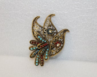 Vintage BSK brooch Rhinestones and Turquoise beads.