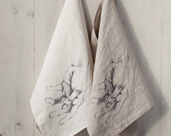 Linen hand towel with printed art hands. Flax kitchen towel. White and natural linen colours.