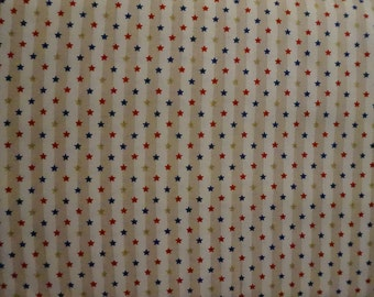 Americana: Beige & White Stripes (with tiny red, blue and gold metallic stars); sold by the yard