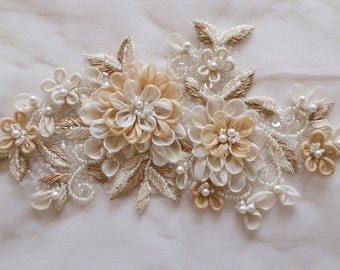 Motif with hand-made silk organza flowers and pearls