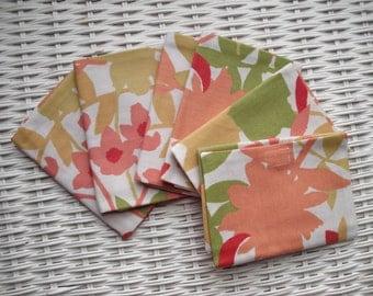 Tissue holder.  Handy for purse & pockets