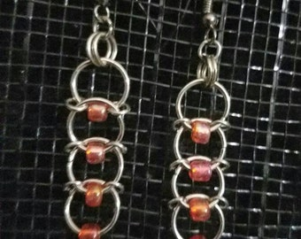 Orange ring dangle earring