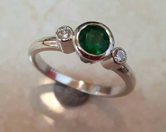 Emerald and diamonds in white gold ring