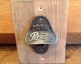 Drink Pepsi Cola bottle opener on pine back