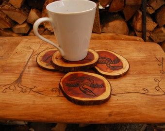 Hand Carved Dragon Coasters made from Yew