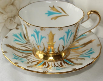 Royal Chelsea: Tea cup and saucer, gold and turquoise