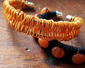 Handmade orange woven wire cuff bracelet